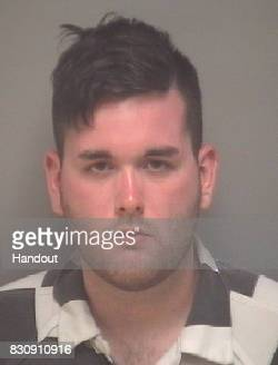 In this handout provided by AlbemarleCharlottesville Regional Jail James Alex Fields Jr of Maumee Ohio poses for a mugshot after he allegedly drove...