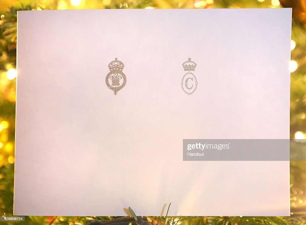 In this handout provided by Clarence House on December 10, 2016, shows the front of the Prince of Wales and Duchess of Cornwall's 2016 Christmas card on a Christmas tree in Clarence House, London. The picture on the card was taken by Chris Jackson of Getty Images, showing the royal couple during their tour of Croatia where they met local performers wearing traditional dress in Tvrda, the old town of the city of Osijek. This handout photo may only be used in for editorial reporting purposes for the contemporaneous illustration of events, things or the people in the image or facts mentioned in the caption. Reuse of the picture may require further permission from the copyright holder.')