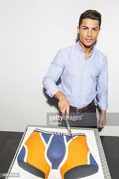 In this handout provided by CR7 on November 2 Cristiano Ronaldo cuts a cake to celebrate the first year anniversary of the global launch of the his...