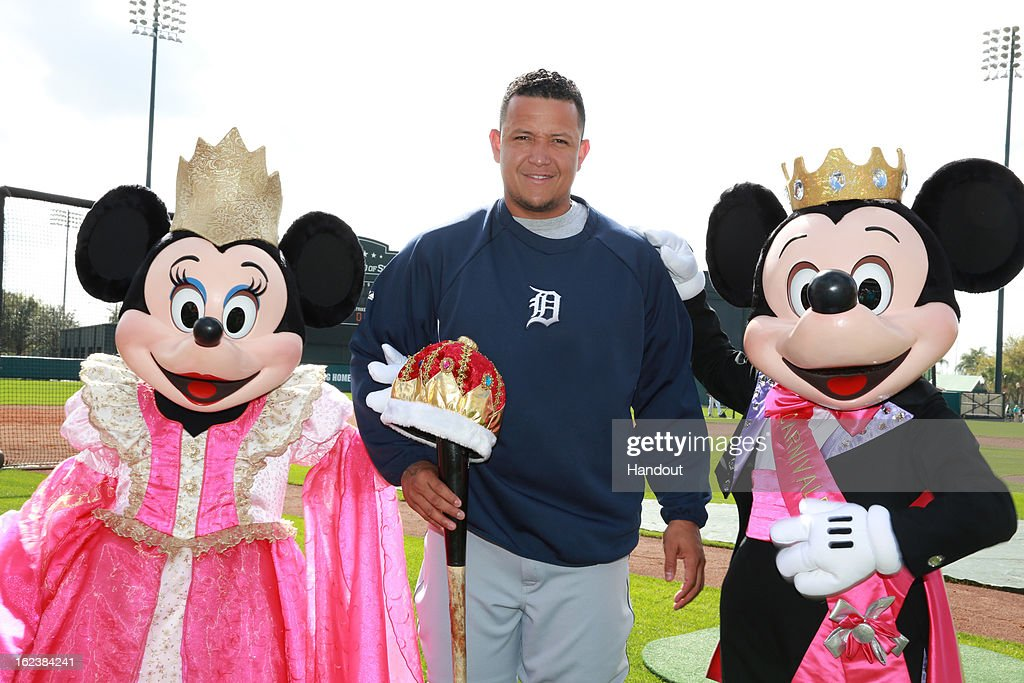 In this handout provided by Disney, 2012 MLB Triple Crown winner <a gi-track='captionPersonalityLinkClicked' href=/galleries/search?phrase=Miguel+Cabrera&family=editorial&specificpeople=202141 ng-click='$event.stopPropagation()'>Miguel Cabrera</a> poses with Mickey and Minnie Mouse at ESPN Wide World of Sports Complex on February 22, 2013 in Lake Buena Vista, Florida. Cabrera and the Detroit Tigers are visiting the Atlanta Braves today for the first game of MLB spring training. Last season, Cabrera became the first magor league player to capture the triple crown in 45 years.