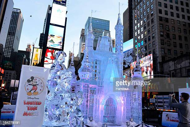 In this handout provided by Disney Parks Disney Parks unveiled a 25foottall000pound castle made of ice as the sun rose over Times Square October 17...