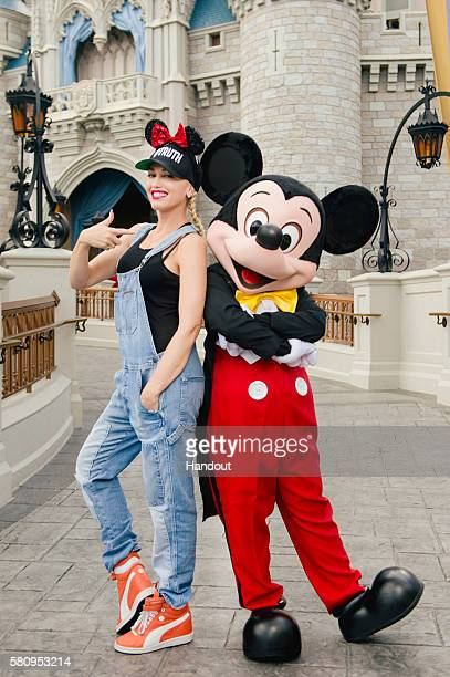 In this handout provided by Disney Parks singersongwriter Gwen Stefani meets up with Mickey Mouse on July 25 2016 at Magic Kingdom Park in Lake Buena...