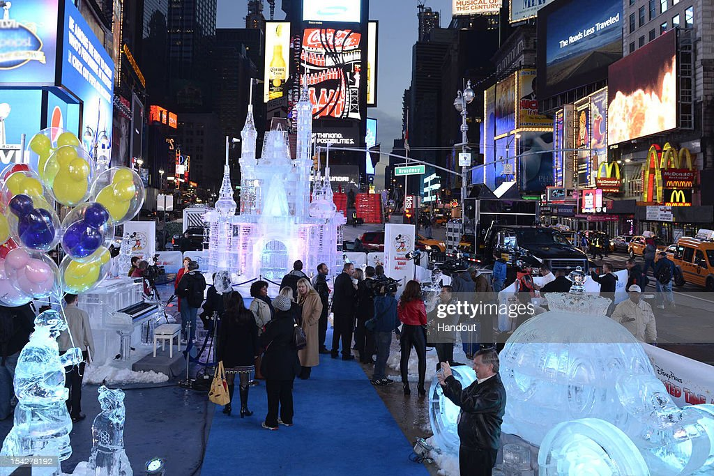In this handout provided by Disney Parks, surrounded by illuminated ice sculptures of Cinderella's Coach and an ice-encased piano, Disney Parks unveiled a 25-foot-tall, 45,000-pound castle made of ice as the sun rose over Times Square October 17, 2012 in New York City. The icy structure was unveiled during the Disney Parks announcement of 'Limited Time Magic' that will take place throughout 2013 at Disneyland Resort in California and Walt Disney World Resort in Florida. Next year, each week at the Disney theme parks will be highlighted by a different surprise or guest enhancement for a one-week-only engagement. Each weekly surprise, many never-before-seen in the Disney Parks, will include entertainment, dining, character experiences and more. Each one will disappear after seven days and make way for the next week's Limited Time Magic experience. Combined with the heat of the morning and early-afternoon sun, the ice castle in Times Square -- which took more than 12 hours to construct and craft -- demonstrates the short-lived nature of Disney's Limited Time Magic.