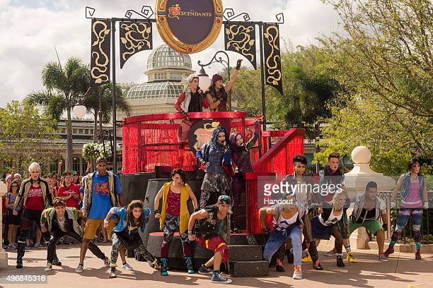 In this handout provided by Disney Parks The cast of Disney Channel Original Movie 'Descendants' Cameron Boyce who plays Carlos Booboo Stewart who...