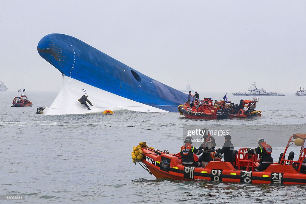In this handout provided by Donga Daily, The Republic of Korea Coast Guard work at the site of ferry sinking accident off the coast of Jindo Island on April 16, 2014 in Jindo-gun, South Korea. Four people are confirmed dead and almost 300 are reported missing. The ferry identified as the Sewol is reported to have been carrying around 470 passengers, including students and teachers, as it travelled to Jeju island.