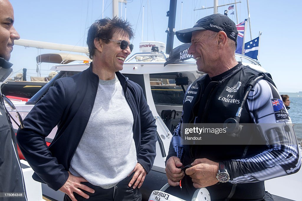 In this handout provided by Emirates, <a gi-track='captionPersonalityLinkClicked' href=/galleries/search?phrase=Tom+Cruise&family=editorial&specificpeople=156405 ng-click='$event.stopPropagation()'>Tom Cruise</a> talks with Emirates Team New Zealand Managing Director Grant Dalton after the Louis Vuitton Cup Round Robin 5 race against Team Luna Rossa Challenge on July 28, 2013 in San Francisco, California.