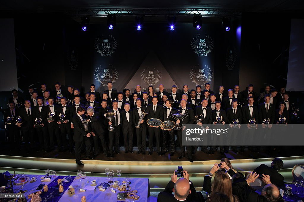 In this handout provided by Federation Internationale de l'Automobile (FIA), award winners stand onstage with their trophies presented at the FIA Prize Giving Gala 2012 on December 7, 2012 in Istanbul, Turkey.