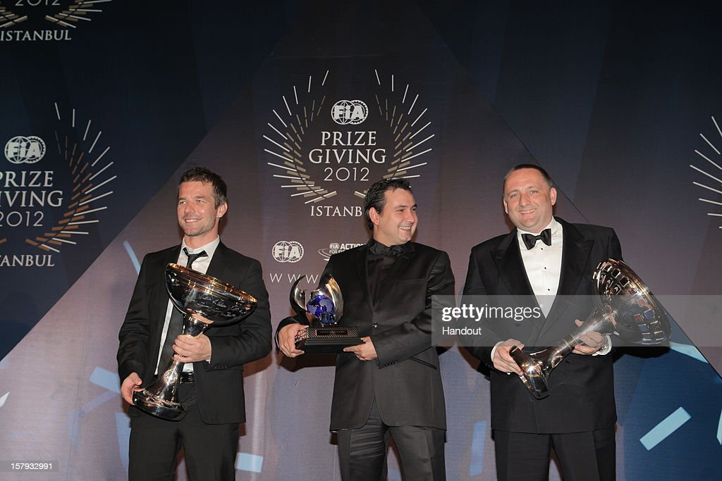 In this handout provided by Federation Internationale de l'Automobile (FIA), Sebastien Loeb of France, Daniel Elena of Monaco and team principal Yves Matton of Citroen World Rally Team hold their FIA World Rally Championship awards presented at the FIA Prize Giving Gala 2012 on December 7, 2012 in Istanbul, Turkey.