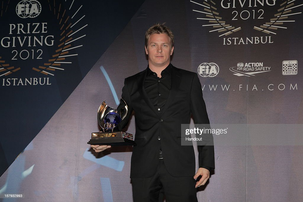 In this handout provided by Federation Internationale de l'Automobile (FIA), Kimi Raikonnen of Finland poses with his FIA Formula One World Championship award presented at the FIA Prize Giving Gala 2012 on December 7, 2012 in Istanbul, Turkey.
