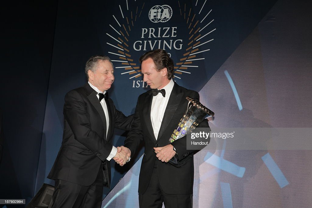 In this handout provided by Federation Internationale de l'Automobile (FIA), FIA President <a gi-track='captionPersonalityLinkClicked' href=/galleries/search?phrase=Jean+Todt&family=editorial&specificpeople=206323 ng-click='$event.stopPropagation()'>Jean Todt</a> (L) shakes hands with <a gi-track='captionPersonalityLinkClicked' href=/galleries/search?phrase=Christian+Horner&family=editorial&specificpeople=228706 ng-click='$event.stopPropagation()'>Christian Horner</a>, winner of the FIA Formula One World Championship constructor's trophy, presented at the FIA Prize Giving Gala 2012 on December 7, 2012 in Istanbul, Turkey.