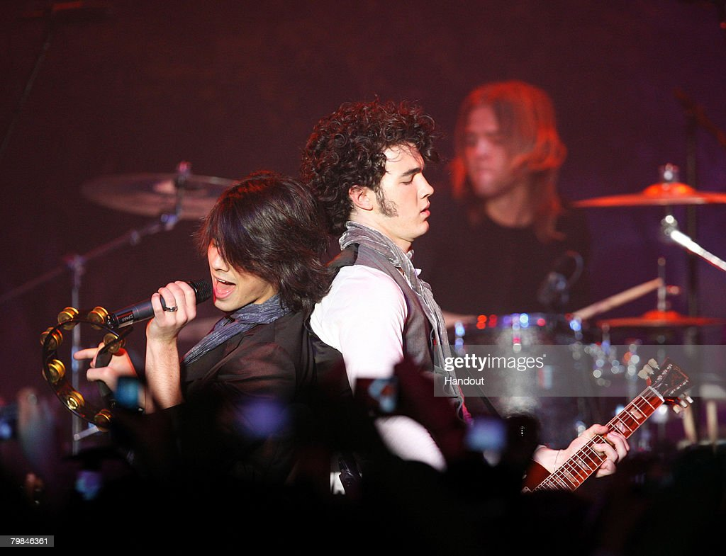 In this handout provided by General Motors, Joe and Kevin Jonas of The Jonas Brothers perform at Chevy Rocks the Future, an entertainment and education event designed to inspire Los Angeles-area school children to protect the environment at The Walt Disney Studios on February 19, 2008 in Burbank, California.