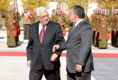 In this handout provided by GPO Palestinian President Mahmoud Abbas talks with Jordan's King Abdullah December 2 2012 in Amman Jordan After last week...