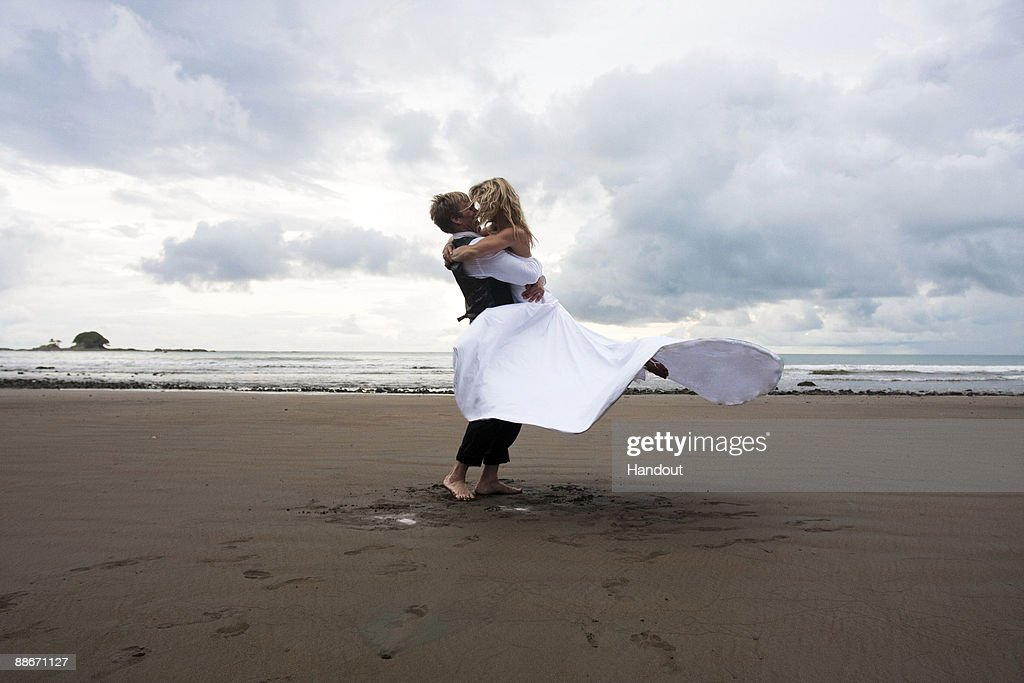 In this handout provided by Gretchen Bleiler, Olympic snowboarder Gretchen Bleiler and Chris Hotell celebrate during their wedding on June 19, 2009 in Dominical, Costa Rica.
