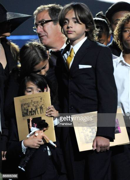 In this handout provided by Harrison Funk and Kevin Mazur Prince Michael Jackson II Paris Jackson and Prince Michael Jackson attend Michael Jackson's...