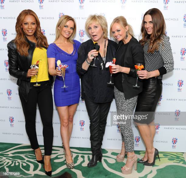 In this handout provided by Harvey Nichols Melanie Brown Geri Halliwell Jennifer Saunders Emma Bunton and Melanie Chisholm toast with their cocktails...