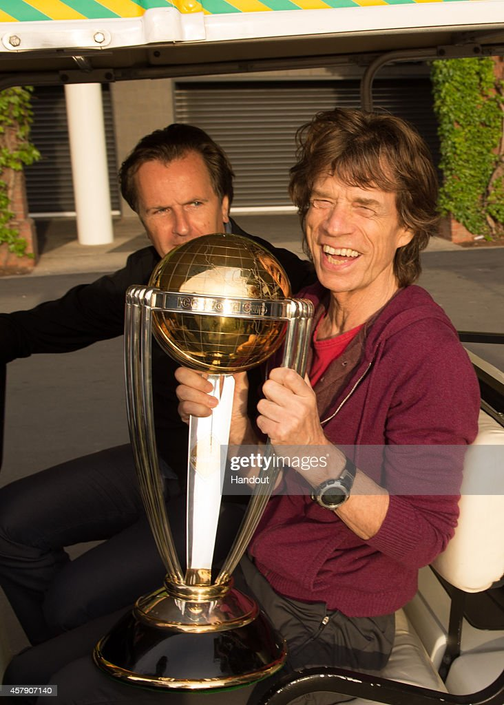 In this handout provided by ICC Cricket World Cup 2015, <a gi-track='captionPersonalityLinkClicked' href=/galleries/search?phrase=Mick+Jagger&family=editorial&specificpeople=201786 ng-click='$event.stopPropagation()'>Mick Jagger</a> from The Rolling Stones poses with the ICC Cricket World Cup trophy as he and Charlie Watts were given a private tour of the Bradman Museum by Don Bradmans son John, at the Adelaide Oval on October 23, 2014 in Adelaide, Australia.