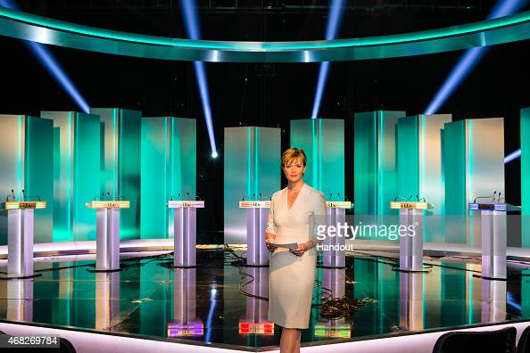 In this handout provided by ITV Julie Etchingham prepares in front of the seven lecterns set up for Green Party leader Natalie Bennett Liberal...