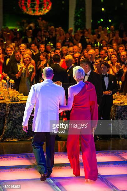 In this handout provided by Le Palais Princier Prince Albert II of Monaco and Princess Charlene of Monaco arrive at the dinner during the Monaco Red...