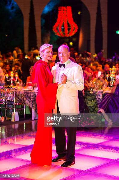 In this handout provided by Le Palais Princier Princess Charlene of Monaco and Prince Albert II of Monaco dance during the Monaco Red Cross Gala on...