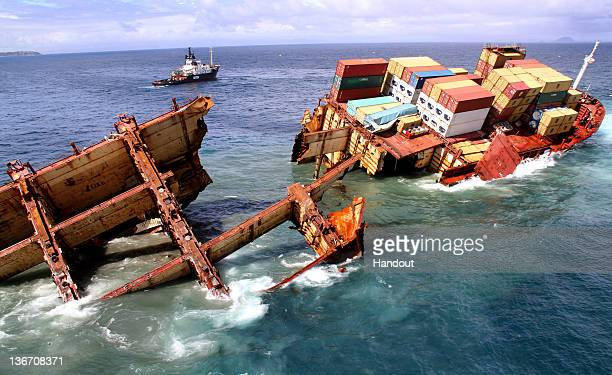 In this handout provided by LOC/Maritime New Zealand MV Rena is seen in two pieces as the stern falls off Astrolabe Reef on January 10 2012 in...
