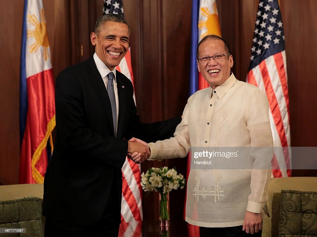 In this handout provided by Malacanang Photo Bureau', US president <a gi-track='captionPersonalityLinkClicked' href=/galleries/search?phrase=Barack+Obama&family=editorial&specificpeople=203260 ng-click='$event.stopPropagation()'>Barack Obama</a> shakes hands with Philippine President Benigno Aquino at the presidential palace on April 28, 2014 in Manila, Philippines. The Philippines trip is the last leg of his four-nation Southeast Asian visit highlighted by the signing of a ten-year Enhanced Defense Cooperation Agreement between the US and the Philippines. The defense agreement involves greater access of US troops in military bases in the Philippines as well as rotational deployment of US air and sea assets in the country. The United States continues to be a major trading partner of the Philippines, with total trade amounting to US$14.5 billion in 2013. Last year, U.S. was the second largest export destination of the Philippines after Japan, with exports reaching US$7.8 billion.