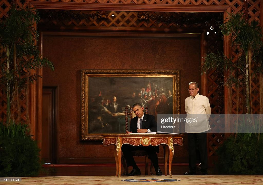 In this handout provided by Malacanang Photo Bureau', US president Barack Obama signs the palace guestbook during his two-day State visit at the presidential palace on April 28, 2014 in Manila, Philippines. The Philippines trip is the last leg of his four-nation Southeast Asian visit highlighted by the signing of a ten-year Enhanced Defense Cooperation Agreement between the US and the Philippines. The defense agreement involves greater access of US troops in military bases in the Philippines as well as rotational deployment of US air and sea assets in the country. The United States continues to be a major trading partner of the Philippines, with total trade amounting to US$14.5 billion in 2013. Last year, U.S. was the second largest export destination of the Philippines after Japan, with exports reaching US$7.8 billion.