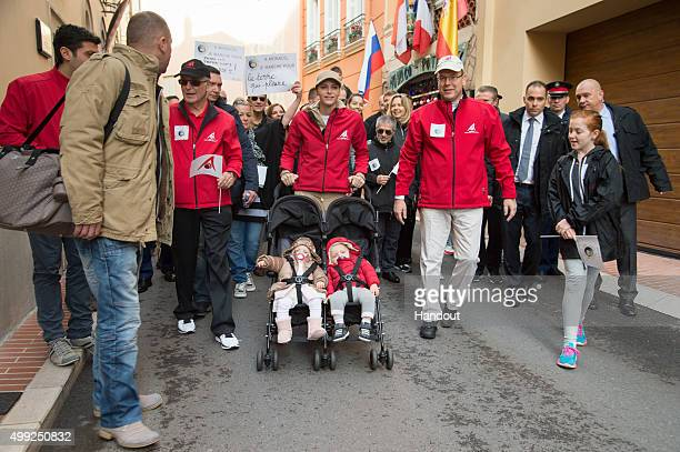 In This Handout Provided by Monaco Press Center Prince Albert of Monaco and Princess Charlene of Monaco walk with their twins Princess Gabriella of...