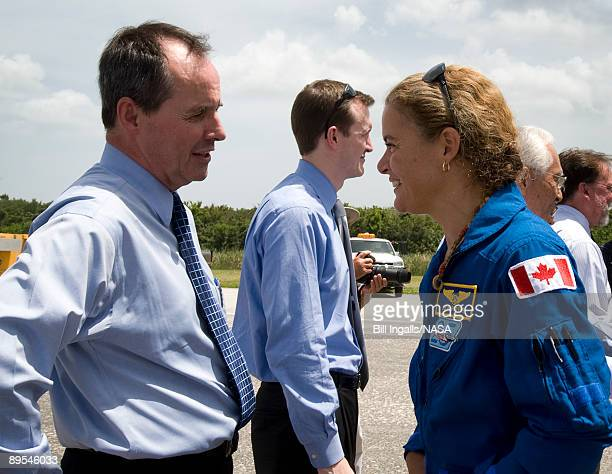 In this handout provided by NASA Benoit Marcotte director general of Canadian Space Agency Operations welcomes home Canadian Space Agency's Julie...