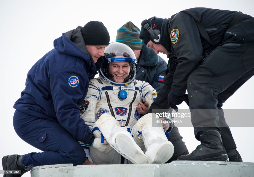 In this handout provided by NASA, Expedition 38 Flight Engineer Sergey Ryazanskiy of the Russian Federal Space Agency, Roscosmos, is helped out of the Soyuz Capsule just minutes after he and Commander Oleg Kotov of the Roscosmos, and, Flight Engineer Mike Hopkins of NASA (not pictured) landed in their Soyuz TMA-10M spacecraft on March 11 near the town of Zhezkazgan, Kazakhstan. Hopkins, Kotov and Ryazanskiy returned to Earth after five and a half months onboard the International Space Station where they served as members of the Expedition 37 and 38 crews.