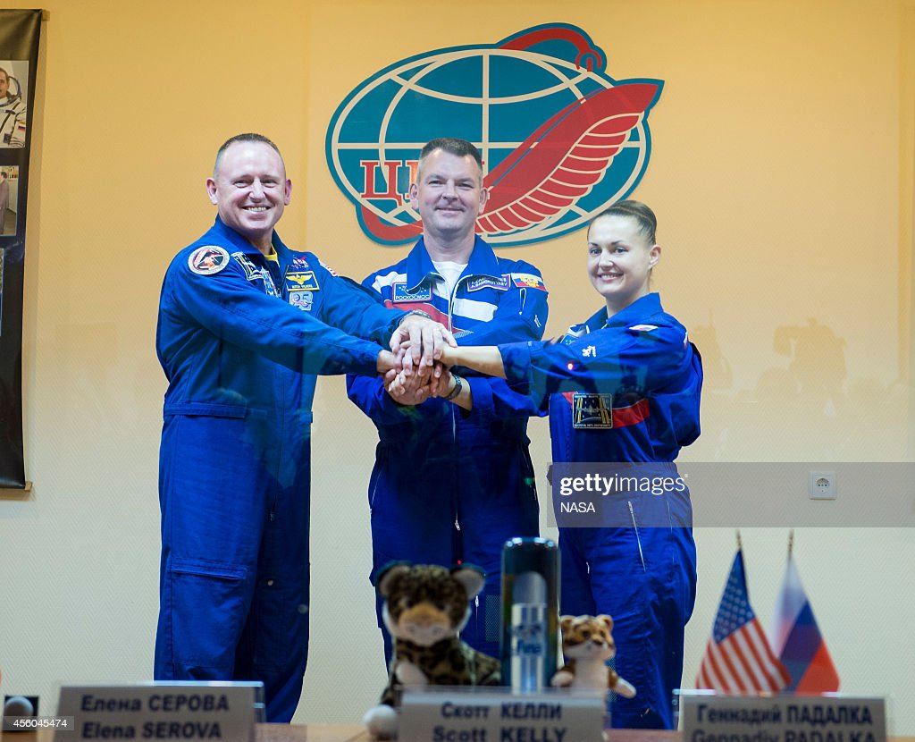 In this handout provided by NASA Expedition 41 prime crew members Flight Engineer Barry Wilmore of NASA Soyuz Commander Alexander Samokutyaev of the...