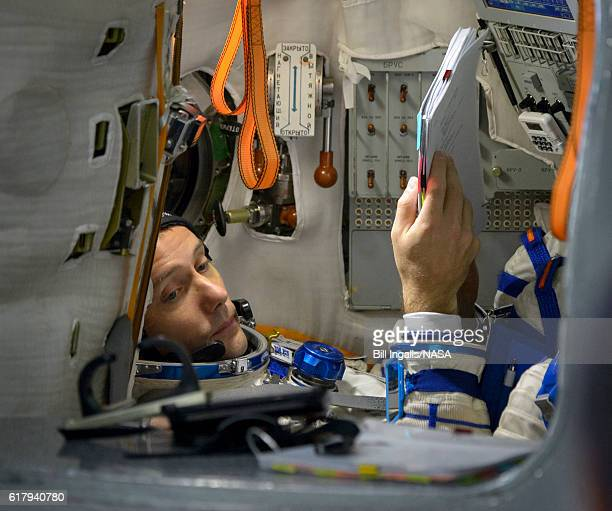 In this handout provided by NASA Expedition 50 ESA astronaut Thomas Pesquet is seen inside the Soyuz simulator during final qualification exams on...
