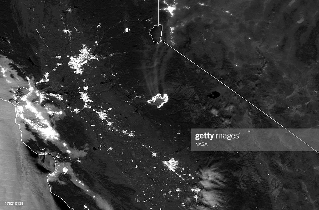 In this handout provided by NASA from the Suomi NPP satellite shows the drought-fueled Rim fire (C) burning on August 23, 2013 near Stanislaus National Forest, California. The Rim Fire continues to burn out of control and threatens thousands of homes and structures outside of Yosemite National Park.