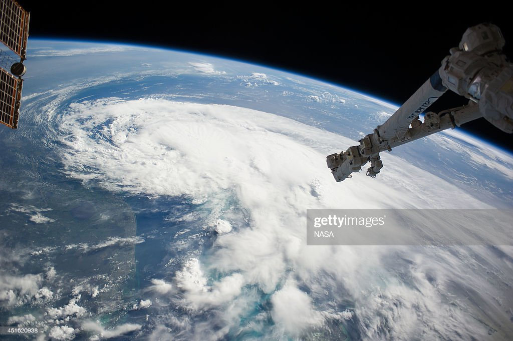 In this handout provided by NASA from the the Earth-orbiting International Space Station, weather system Arthur travels up the east coast of the United States in the Atlantic Ocean near Florida on July 2, 2014 in space. The robotic arm of the Space Station Remote Manipulator System or Canadarm2 is seen at upper right. According to reports, Arthur has begun moving steadily northward at around 5 kt. and the tropical storm is expected to strike the North Carolina Outer Banks over the Fourth of July holiday.