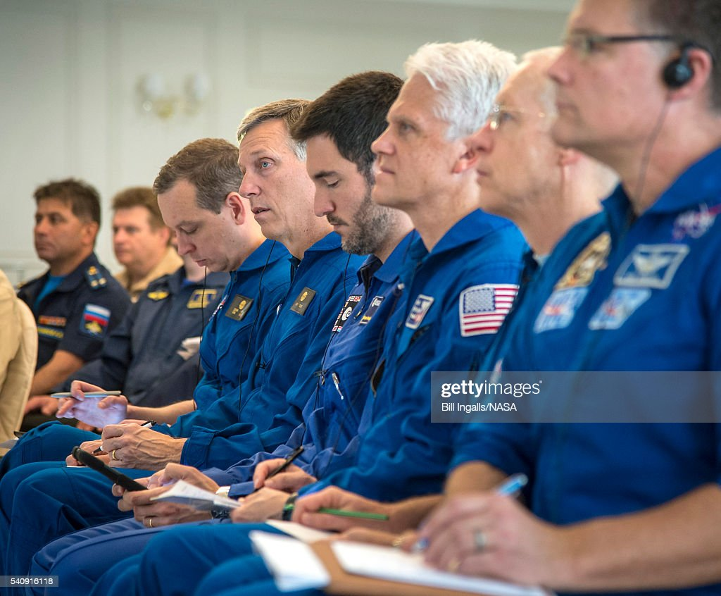 In this handout provided by NASA, NASA, ESA, and Roscosmos team members, along with the Russian Search and Recovery Force, meet to discusss the readiness for the landing of Expedition 47 crew members Tim Kopra of NASA, Tim Peake of the European Space Agency, and Yuri Malenchenko of Roscosmos at the Cosmonaut Hotel on June 17, 2016 in Karaganda, Kazakhstan. Kopra, Peake, and Malenchenko are scheduled to land June 18 in their Soyuz TMA-19M spacecraft near Zhezkazgan, Kazakhstan.