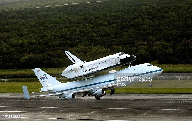 In this handout provided by NASA NASA's Shuttle Carrier Aircraft or SCA with the space shuttle Endeavour mated on top takes off from the Shuttle...