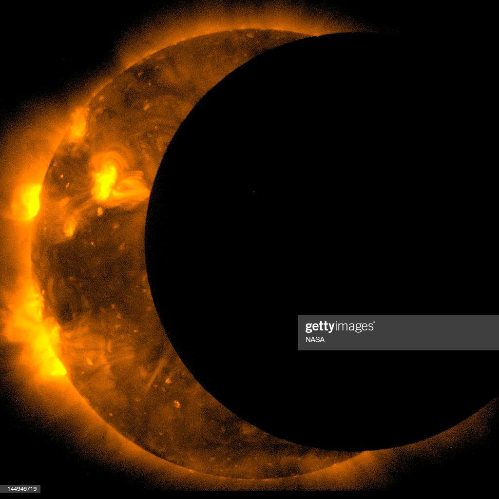In this handout provided by NASA, sun spots are seen as the moon moves into a partial eclipse position after reaching annularity during the first annular eclipse seen in the U.S. since 1994 on May 20, 2012. Differing from a total solar eclipse, the moon in an annular eclipse appears too small to cover the sun completely, leaving a ring of fire effect around the moon. The eclipse is casting a shallow path crossing the West from west Texas to Oregon then arcing across the northern Pacific Ocean to Tokyo, Japan.