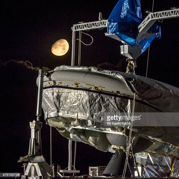 In this handout provided by NASA the Moon sets during a full mission dress rehearsal for the LowDensity Supersonic Decelerator at the US Navy Pacific...