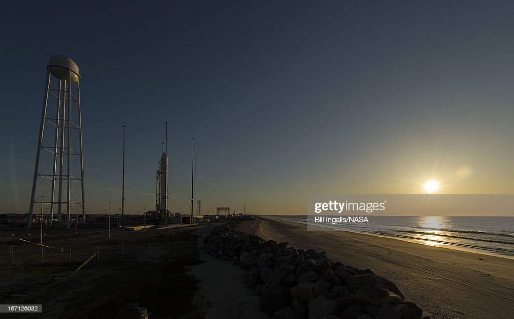 In this handout provided by NASA, The Orbital Sciences Corporation Antares rocket stands during sun rise on the Mid-Atlantic Regional Spaceport (MARS) Pad-0A at the NASA Wallops Flight Facility on April 21, 2013 in Wallops Islandm, Virginia. NASA's commercial space partner, Orbital Sciences Corporation, were due to launch its first Antares yesterday but that has now been delayed due to wind.