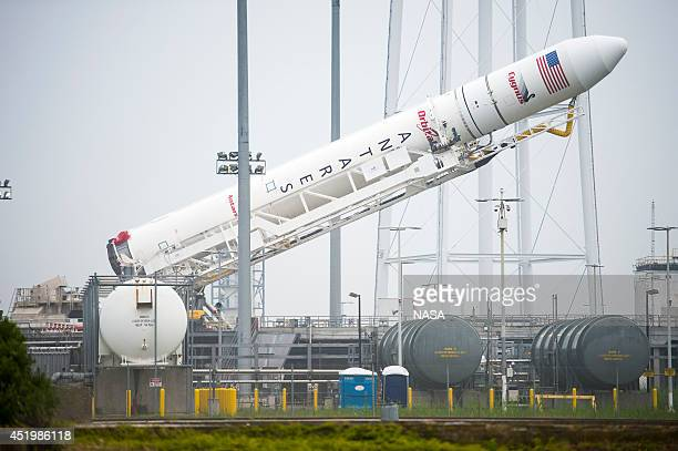 In this handout provided by NASA the Orbital Sciences Corporation Antares rocket with the Cygnus spacecraft onboard is raised at launch Pad0A at...