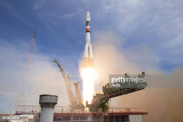 In this handout provided by NASA the Soyuz MS04 rocket carrying Expedition 51 Soyuz Commander Fyodor Yurchikhin of Roscosmos and Flight Engineer Jack...