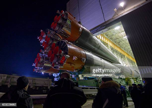 In this handout provided by NASA the Soyuz rocket is rolled out by train to the launch pad at the Baikonur Cosmodrome Kazakhstan Monday Nov 14 2016...