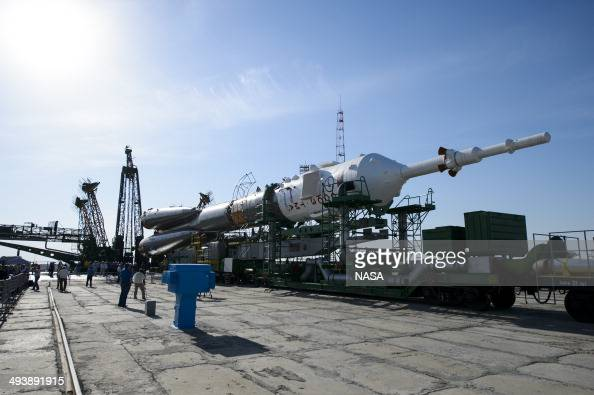 In this handout provided by NASA The Soyuz spacecraft is rolled out by train to launch pad 1 at Baikonur Cosmodrome launch pad on May 26 2014 in...