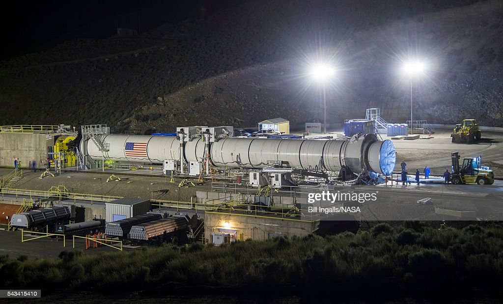 In this handout provided by NASA, the Space Launch System's booster is seen a few hours ahead of the second and final qualification motor (QM-2) test, Tuesday, June 28, 2016, at Orbital ATK Propulsion Systems test facilities in Promontory, Utah. During the Space Launch System flight the boosters will provide more than 75 percent of the thrust needed to escape the gravitational pull of the Earth, the first step on NASA's Journey to Mars.