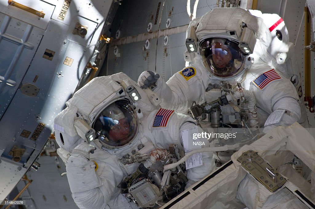 In this handout provided by NASA, with components of the International Space Station in the view, NASA astronauts Andrew Feustel (R) and Michael Fincke are pictured during the STS-134 mission's third spacewalk May 25, 2011. They coordinated their shared activity with NASA astronaut Greg Chamitoff, who stayed in communication with the pair and with Mission Control Center in Houston from inside the station.