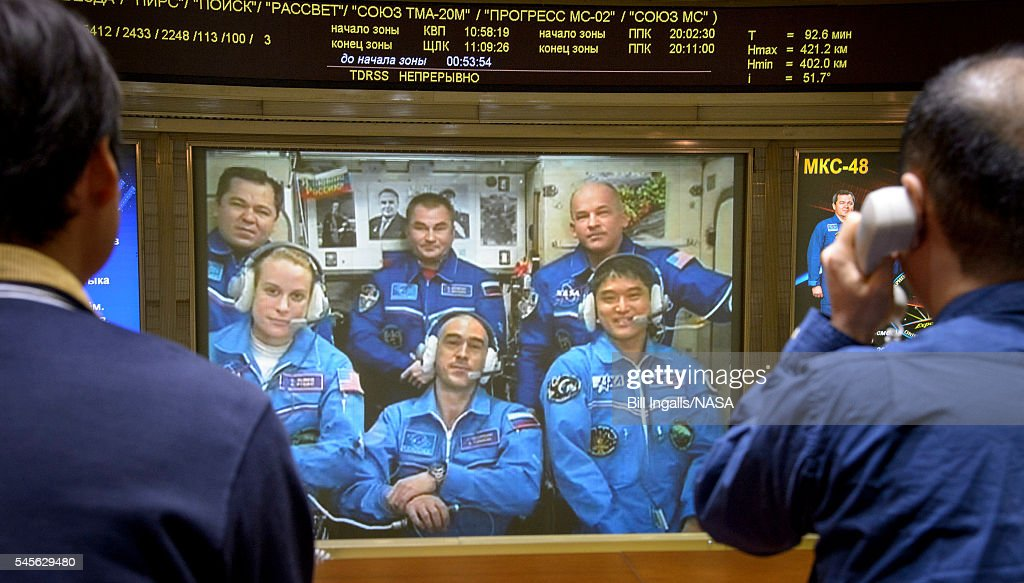 In this handout provided by NASAExpedition 48 Flight Engineers Oleg Skripochka top left and Alexey Ovchinin of Roscosmos top center along with...