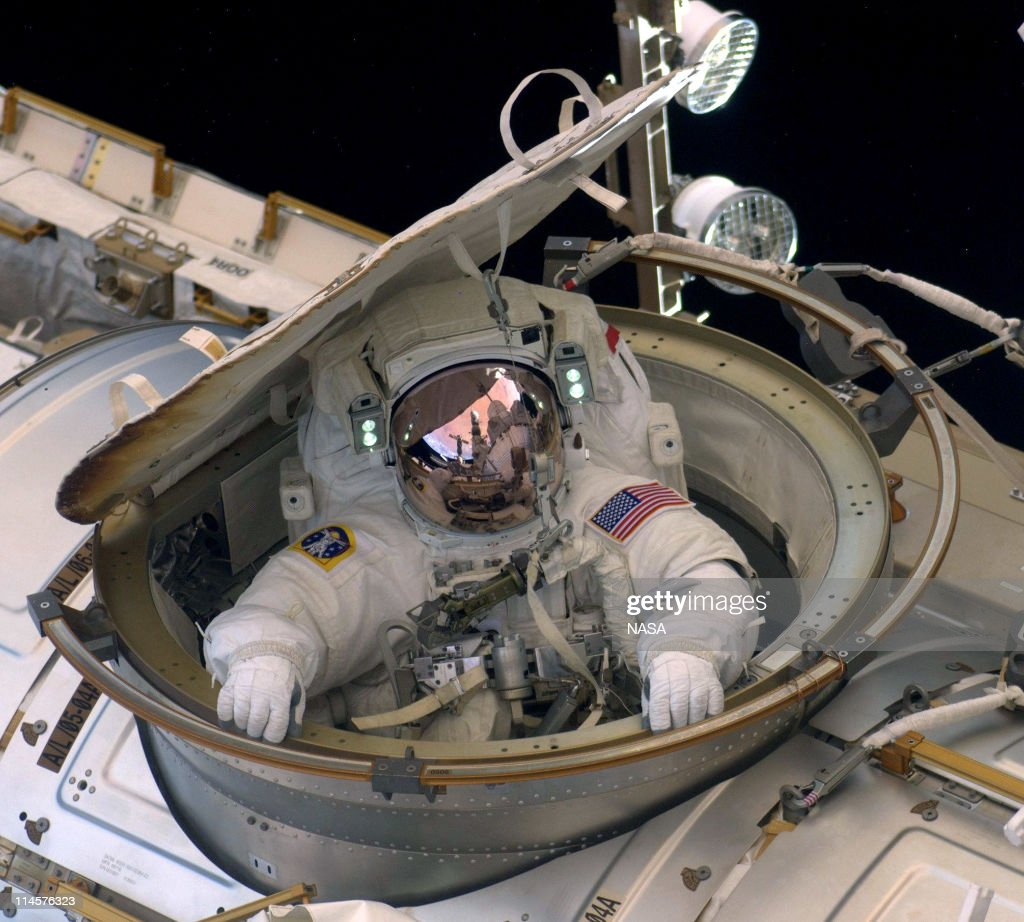 In this handout provided by National Aeronautics and Space Administration (NASA), Astronaut Andrew Feustel reenters the space station after completing n 8-hour, 7-minute spacewalk at 10:12 a.m. EDT as NASA space shuttle Endeavour makes its last visit to the International Space Station on May 22, 2011 in space. After 20 years, 25 missions and more than 115 million miles in space, Endeavour is on its final flight to the International Space Station before being retired and donated to the California Science Center in Los Angeles. Capt. Mark E. Kelly, U.S. Rep. Gabrielle Giffords' (D-AZ) husband, will lead mission STS-134 as it delivers the Express Logistics Carrier-3 (ELC-3) and the Alpha Magnetic Spectrometer (AMS-2) to the International Space Station.