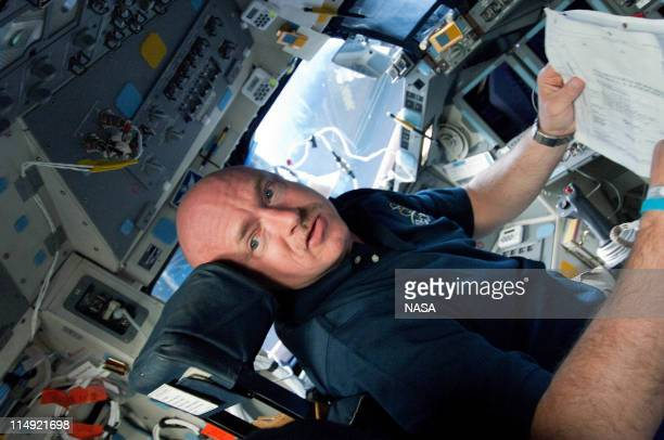 In this handout provided by National Aeronautics and Space Administration Astronaut Mark Kelly STS134 commander gets to work soon after Endeavour...