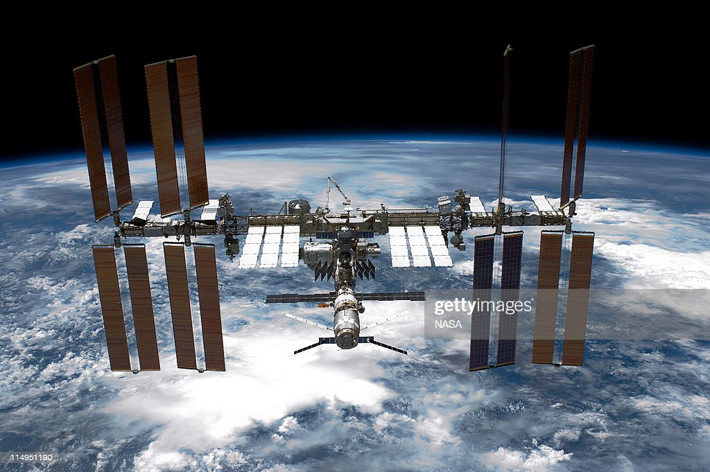 In this handout provided by National Aeronautics and Space Administration back dropped by planet Earth the International Space Station is seen from...