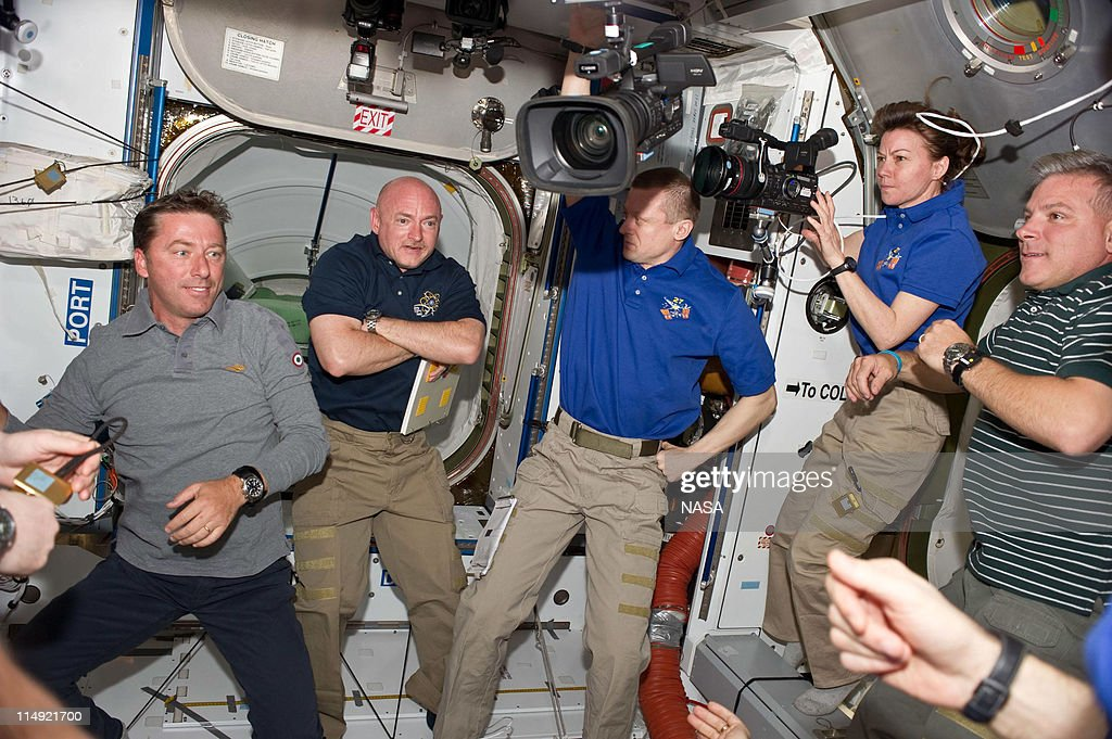 In this handout provided by National Aeronautics and Space Administration STS134 and Expedition 27 crew members are pictured in the Harmony node of...