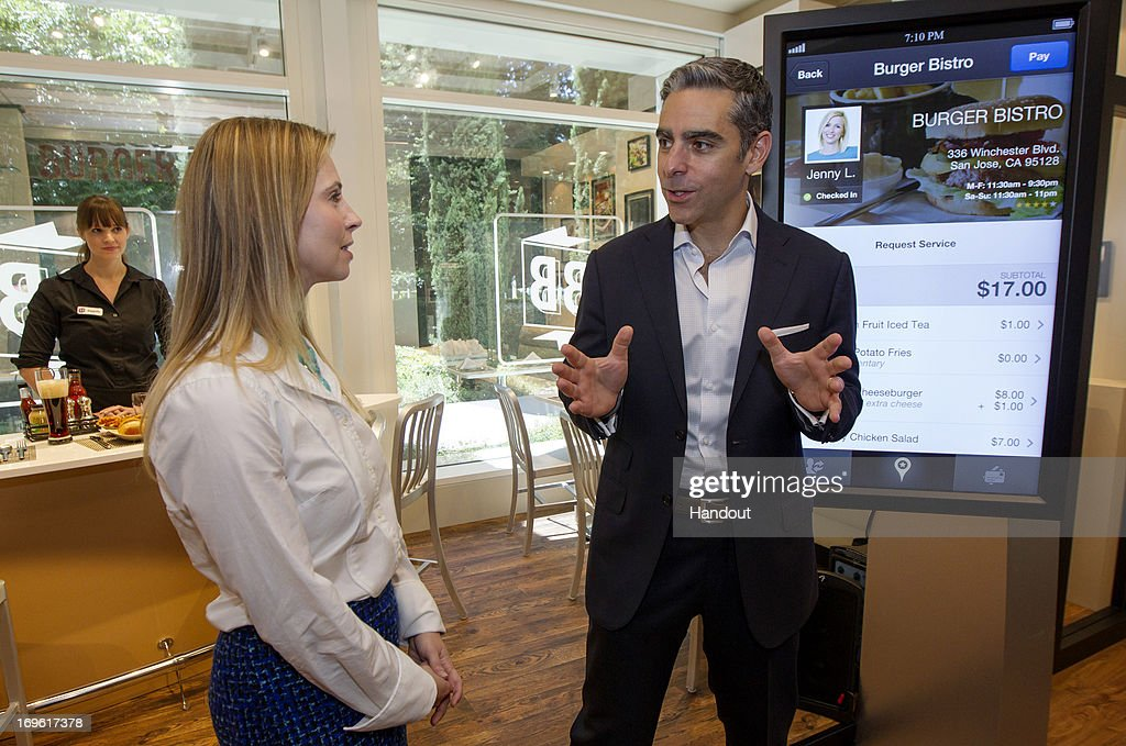 In this handout provided by PayPal, PayPal President David Marcus (R) discusses with a journalist new shopping features that are being rolled out to consumers this year at PayPal headquarters May 21, 2013 in San Jose, California. Marcus discussed consumer shopping behavior and trends, and PayPal's plans to be in two million retail locations nationwide by the end of the year.